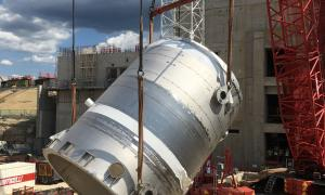 Normal drain tank being lifted into tokamak complex